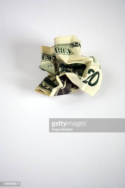 A crumpled up twenty dollar bill