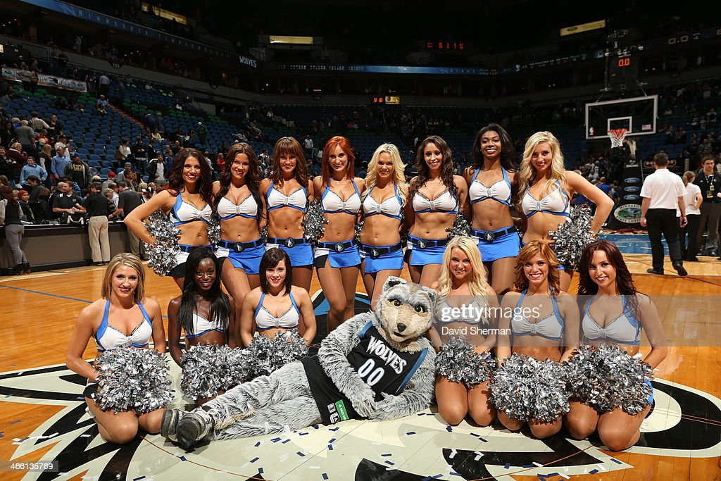 Crunch the mascot of the Minnesota Timberwolves poses for a picture with the dance team before the game against the Boston Celtics on November 16, 2013 at Target Center in Minneapolis, Minnesota.