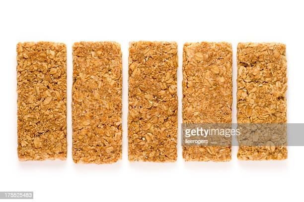 Crunchy oat granola bars isolated on a white background
