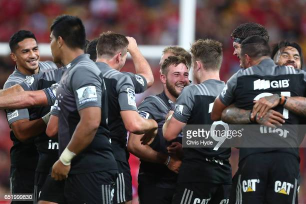 Crusaders celebrate winning the round three Super Rugby match between the Reds and the Crusaders at Suncorp Stadium on March 11 2017 in Brisbane...