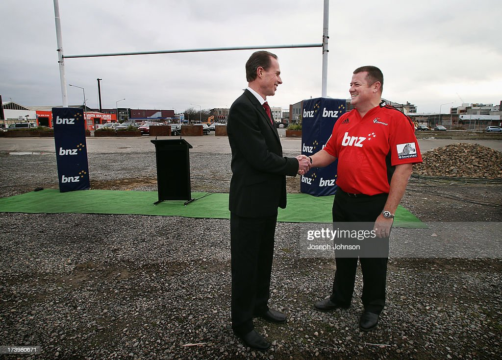 Crusaders CEO Hamish Riach shakes hands with BNZ Head of Business Banking Campbell Parker during a media announcement that BNZ will be naming rights sponsor of the Crusaders on July 19, 2013 in Christchurch, New Zealand.