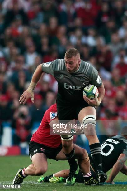 Crusaders Luke Romano is tackled during the Super XV rugby final match between Lions and Crusaders at Ellis Park Rugby stadium on August 5 2017 in...