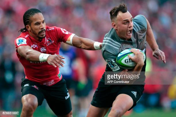 Crusaders' New Zealand Israel Dagg breaks through as Lions' South African Courtnall Skosan attempts to tackle him during the Super XV rugby final...