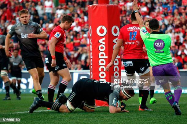 Crusaders' New Zealand Kieran Read scores a try during the Super XV rugby final match between Lions and Crusaders at the Ellis Park Rugby stadium on...