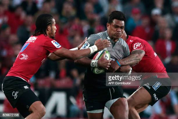 Crusaders Pete Samu is tackled by Lions Courtnall Skosan during the Super XV rugby final match between Lions and Crusaders at Ellis Park Rugby...