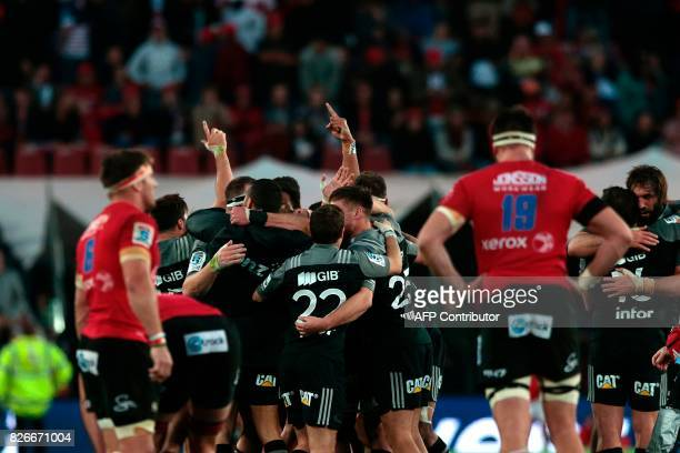 Crusaders players celebrate after winning the Super XV tournament at the end of the Super XV rugby final match against the Lions at Ellis Park Rugby...