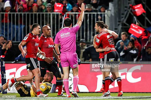 Crusaders players celebrate the try of Mitchell Drummond during the round 16 Super Rugby match between the Crusaders and the Hurricanes at Trafalgar...
