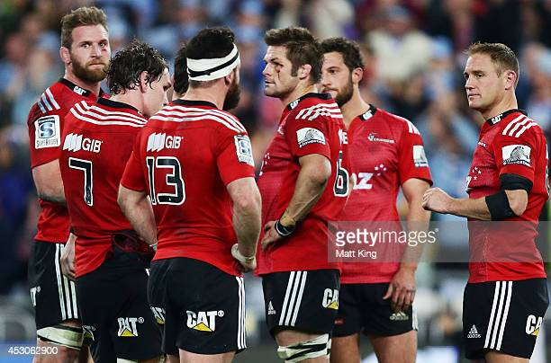 Crusaders players look dejected after the Super Rugby Grand Final match between the Waratahs and the Crusaders at ANZ Stadium on August 2 2014 in...