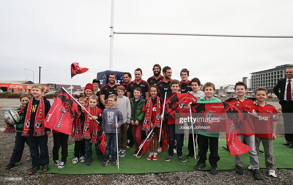 Crusaders players pose for photos with young fans after a media announcement that BNZ will be naming rights sponsor of the Crusaders on July 19, 2013 in Christchurch, New Zealand.