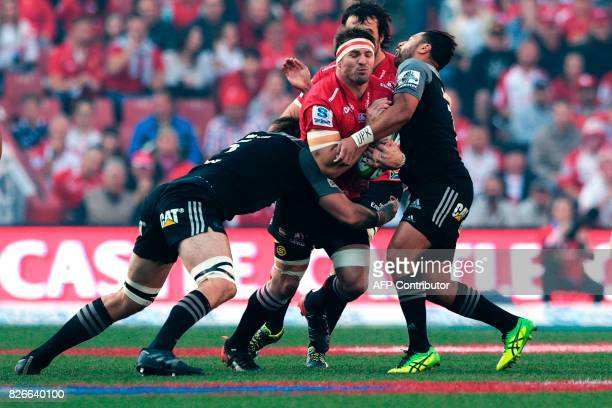 Crusaders players tackle Jaco Kriel during the Super XV rugby final match between Lions and Crusaders at Ellis Park Rugby stadium on August 5 2017 in...