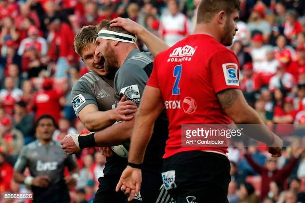 Crusaders' South African Kieran Read celebrates with teammates after scoring a try during the Super XV rugby final match between Lions and Crusaders...