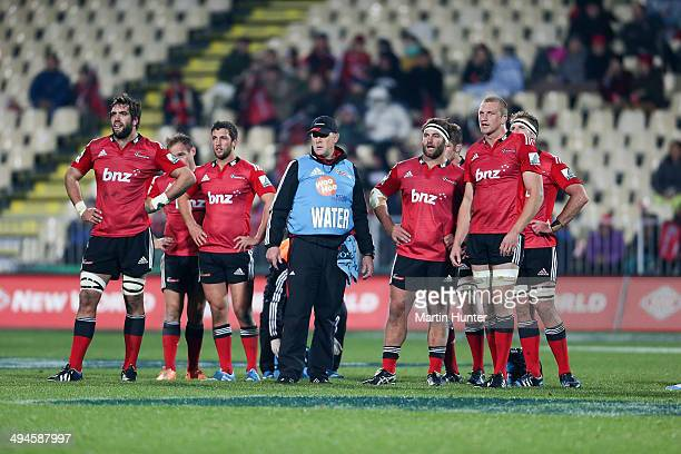Crusaders team mates look on during the round 16 Super Rugby match between the Crusaders and the Western Force at AMI Stadium on May 30 2014 in...