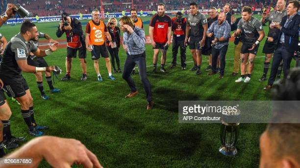 Crusaders's New Zealand head coach Scott Robertson dances as he celebrate with his team during the price ceremony after winning the Super XV rugby...