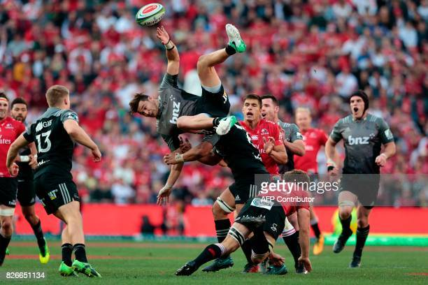 Crusaders's New Zealand midfielder David Havili collides with Lions' South African winger Kwagga Smith during the Super XV rugby final match between...