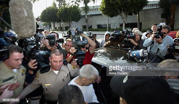 A crush of media surrounds Robert Balke as he enters the car after being released from Mens Central Jail Actor Robert Blake was released on bond...