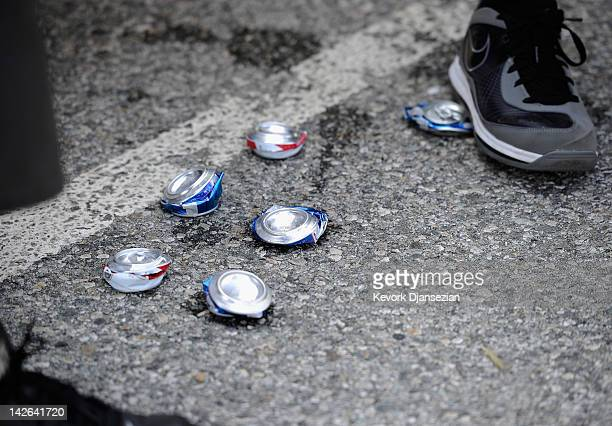 Crushed beer cans are seen as some Los Angeles Dodgers fans are cited for having an open container as they were drinking beer in the parking lot of...