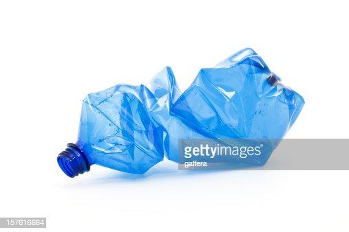 crushed blue plastic bottle