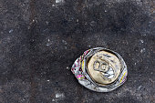 crushed can on the road