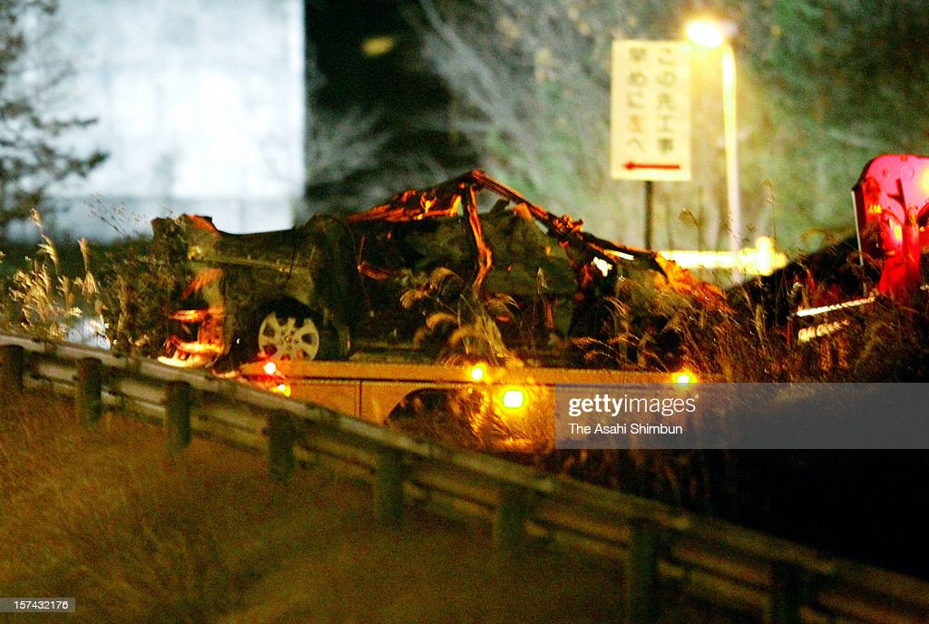 A crushed car is taken out from the collapsed Sasago tunnel while the rescue effort continue at Sasago Tunnel of the Chuo expressway on December 3, 2012 in Koshu, Yamanashi, Japan. The concrete ceiling panels of the tunnel collapsed more than 110 metres and at least 9 people confirmed dead.