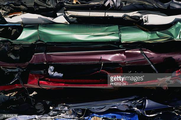 Crushed cars in compactor