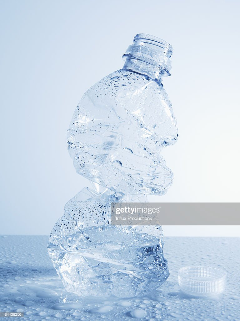 Crushed disposable plastic water bottle : Stock Photo