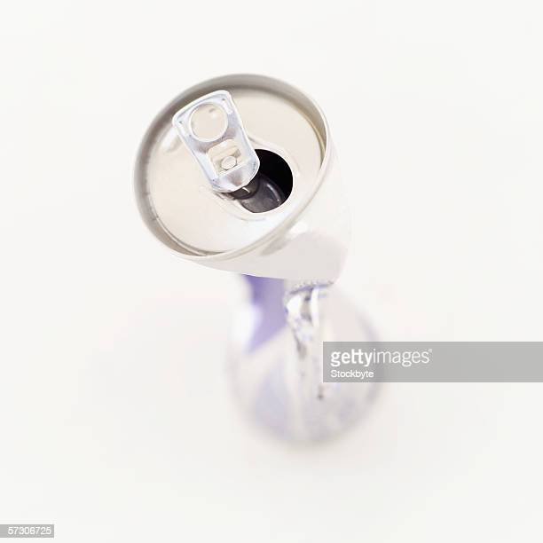 A crushed empty soda can