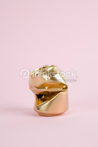 crushed gold can : Stock Photo