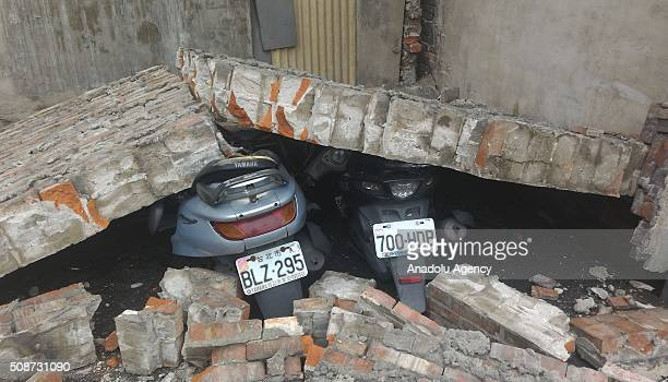 Crushed motorcycles are seen near Xinhua Bus Station Tainan Taiwan on February 6 2016 following a strong earthquake struck Taiwan At least 13 people...