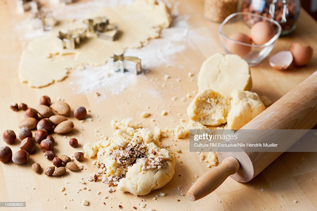 Crushed nuts on cookie dough : Stock Photo