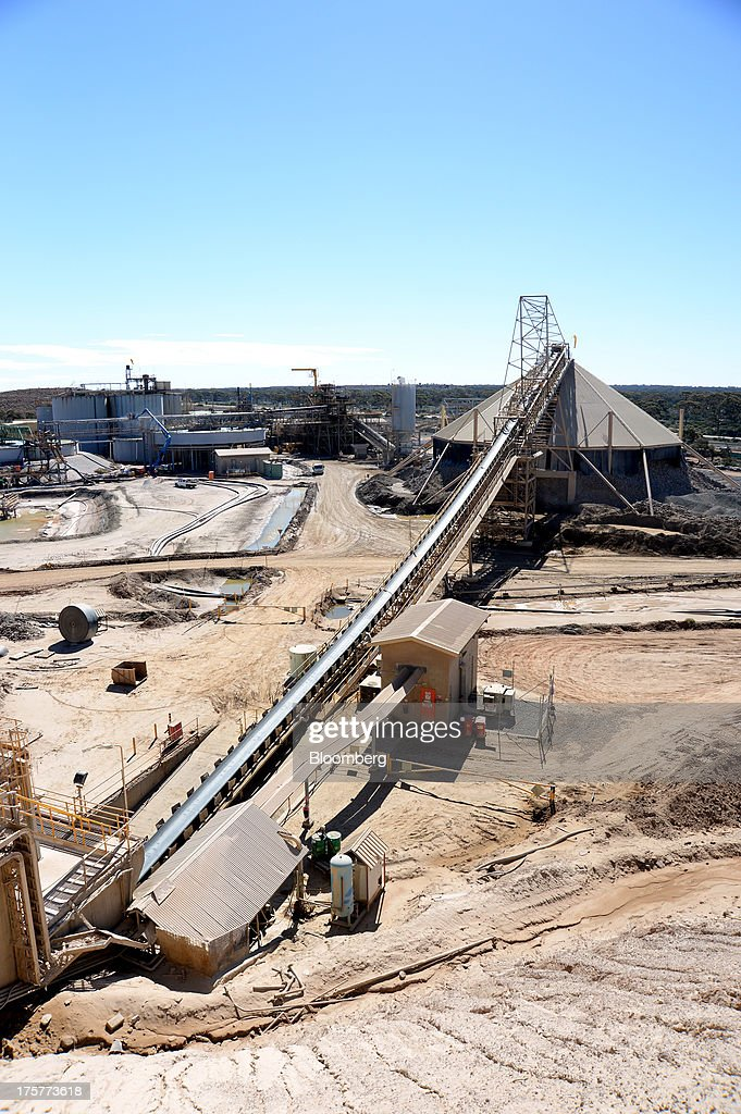 Crushed ore travels up a conveyor belt to a stockpile for the next stage of processing at the Norton Gold Fields Ltd. Paddington operations 35 kilometers north-west of Kalgoorlie, Australia, on Wednesday, Aug. 7, 2013. Norton, the Australian producer controlled by China's Zijin Mining Group Co., is seeking further acquisition targets as falling prices cut the value of mines. Photographer: Carla Gottgens/Bloomberg via Getty Images