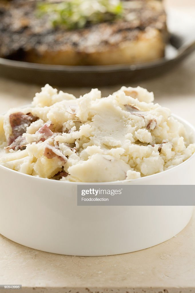 Crushed potatoes in white dish, close up : Stock Photo