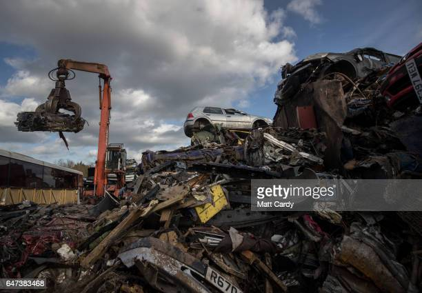 A crushed scrap car is loaded by crane onto a lorry at Pylle Motor Spares and Metal Processing a licensed scrap yard in Pylle near Shepton Mallet on...