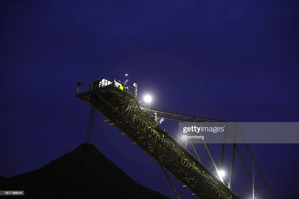 A crushing conveyor is illuminated at night as it transports ore at the G-Resources Group Ltd. Martabe gold and silver mine in Batang Toru, North Sumatra province, Indonesia, on Tuesday, Feb. 12, 2013. G-Resources is scheduled to announce financial results on Feb. 28. Photographer: Dadang Tri/Bloomberg via Getty Images