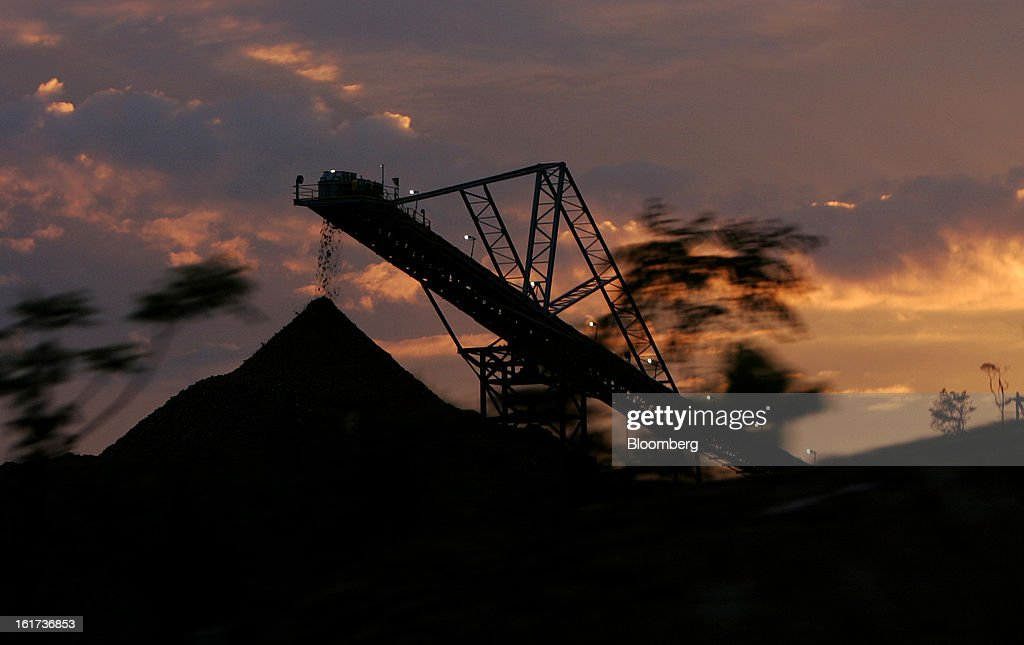 A crushing conveyor is silhouetted against the setting sun as it transports ore at the G-Resources Group Ltd. Martabe gold and silver mine in Batang Toru, North Sumatra province, Indonesia, on Tuesday, Feb. 12, 2013. G-Resources is scheduled to announce financial results on Feb. 28. Photographer: Dadang Tri/Bloomberg via Getty Images