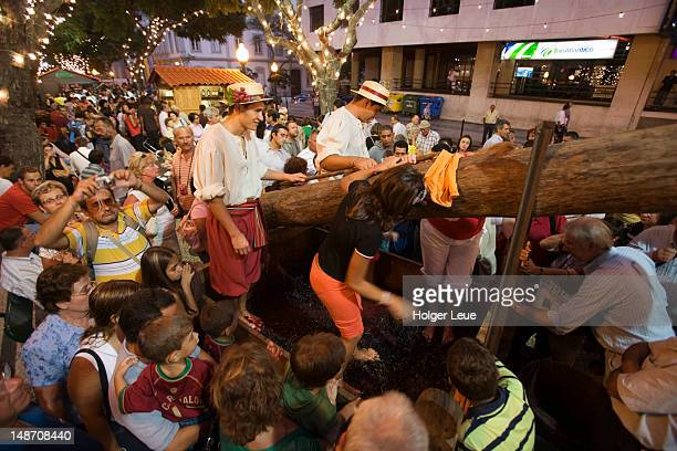 Crushing grapes at Madeira Wine Festival.