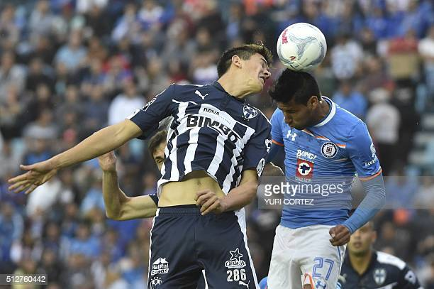 Cruz Azul's forward Jorge Benites vies for the ball with Monterrey's defender Cesar Jasib during their Mexican Clausura tournament football match at...