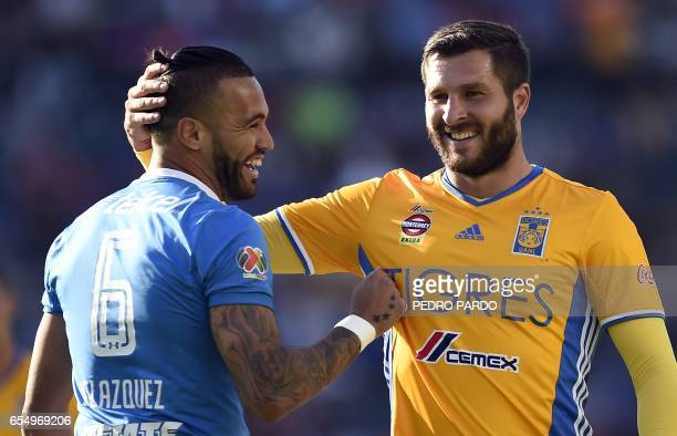 Cruz Azul´s Julian Velazquez and Tigres´forward Andre Pierre Gignac laugh during their Mexican Clausura football tournament match at the Azul Stadium...