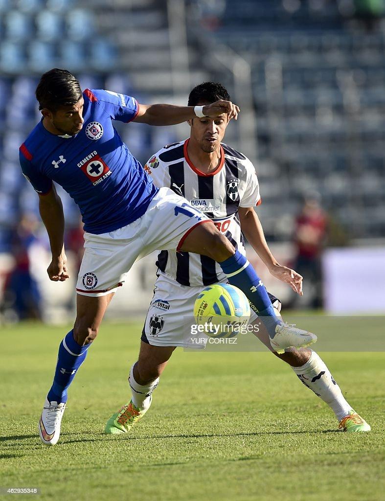Cruz Azul's midfielder Joao Rojas vies for the ball with Monterrey's defender Severo Meza during their Clausura tournament football match at the Azul...