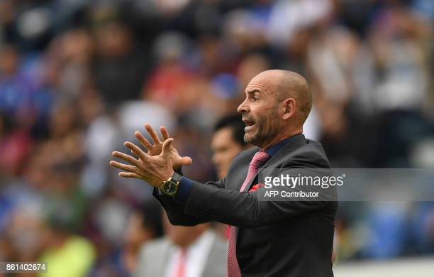 Cruz Azul's Spanish coach Francisco 'Paco' Jemez gives instructions to his players during the Mexican Apertura football tournament match against...