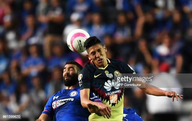 Cruz Azul's Uruguayan forward Martin Cauteruccio and America's defender Edson Alvarez vie for the ball during their Mexican Apertura football...