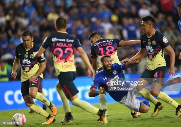 Cruz Azul's Uruguayan forward Martin Cauteruccio falls during the Mexican Apertura football tournament match against America at the Azul stadium in...