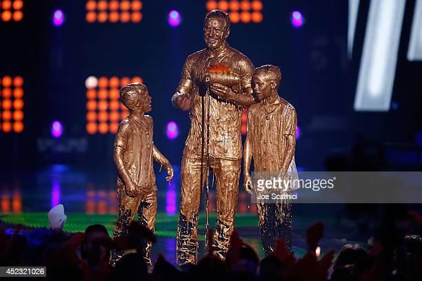 Cruz Beckham David Beckham and Romeo Beckham get slimed onstage at Nickelodeon Kids' Choice Sports Awards 2014 at Pauley Pavilion on July 17 2014 in...