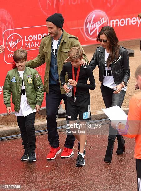 Cruz Beckham David Beckham and Victoria Beckham congratulate Romeo Beckham after he finished the Childrns Marathon during the London Marathon on...