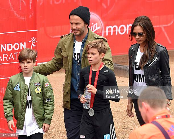 Cruz Beckham David Beckham and Victoria Beckham congratulate Romeo Beckham after he completed the Junior Marathon during the London Marathon on April...