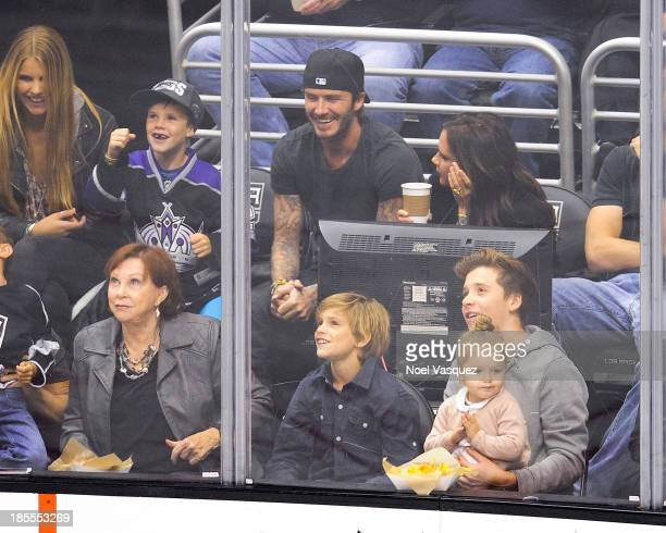 Cruz Beckham David Beckham Romeo Beckham Victoria Beckham Harper Beckham and Brooklyn Beckham attend a hockey game between the Calgary Flames and the...