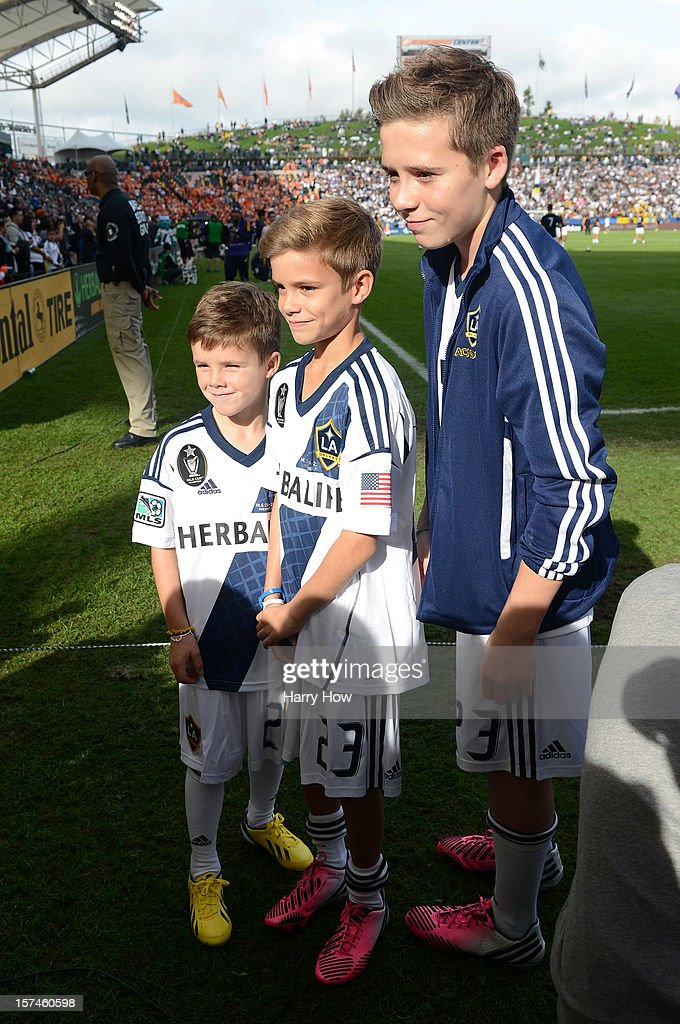 Cruz Beckham, Romeo Beckham and Brooklyn Beckham, the sons of David Beckham #23 of Los Angeles Galaxy stand on the field before the 2012 MLS Cup at The Home Depot Center on December 1, 2012 in Carson, California.