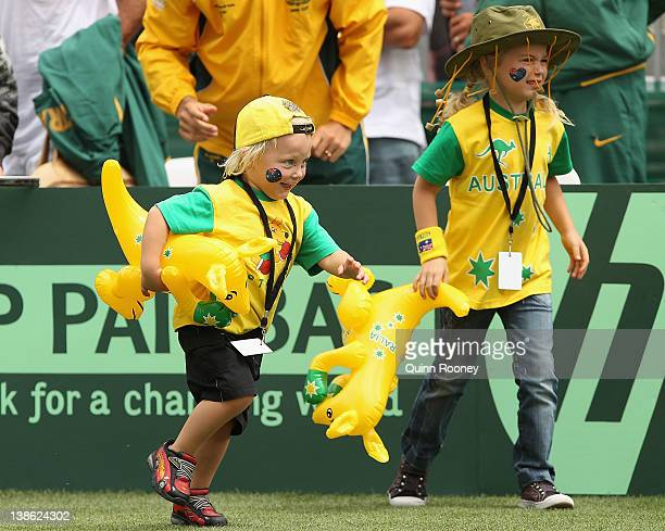 Cruz Hewitt and Mia Hewitt run on the court to congratulate their dad Lleyton Hewitt of Australia after he won his singles match against Zhang Ze of...