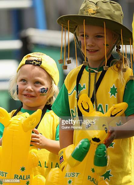 Cruz Hewitt and Mia Hewitt support their dad Lleyton Hewitt of Australia during his singles match against Zhang Ze of China during day one of the...