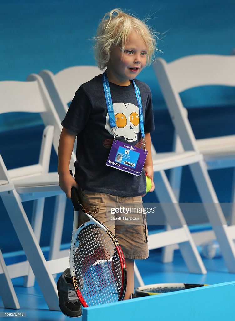 Cruz Hewitt, the son of Lleyton Hewitt of Australia watches his father during a practice session ahead of the 2013 Australian Open at Melbourne Park on January 13, 2013 in Melbourne, Australia.