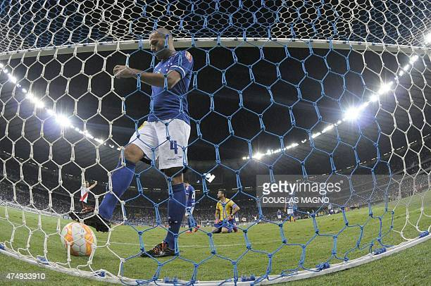 Cruzeiro player Bruno Rodrigo retrieves the ball from their goal after having been scored by River Plate during their 2015 Libertadores Cup match at...